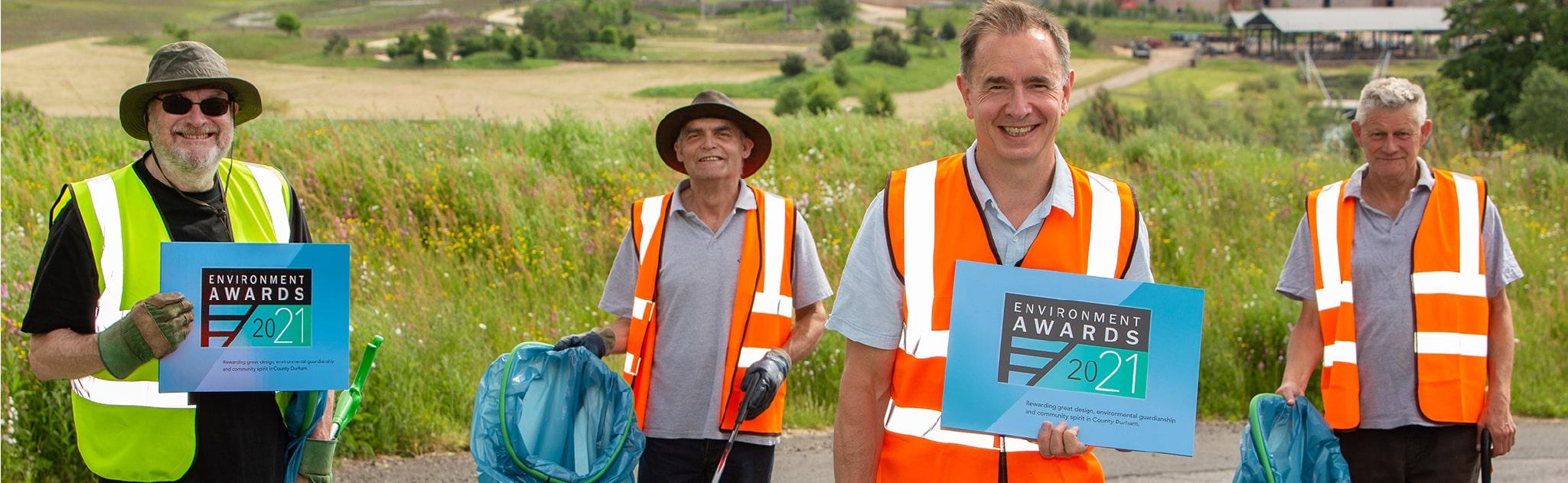 Men smiling litter picking with environment awards 2021