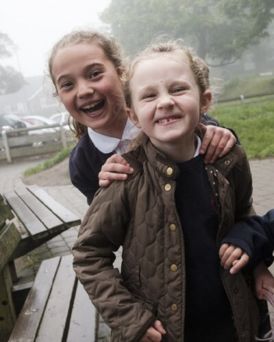 2 school girls smiling